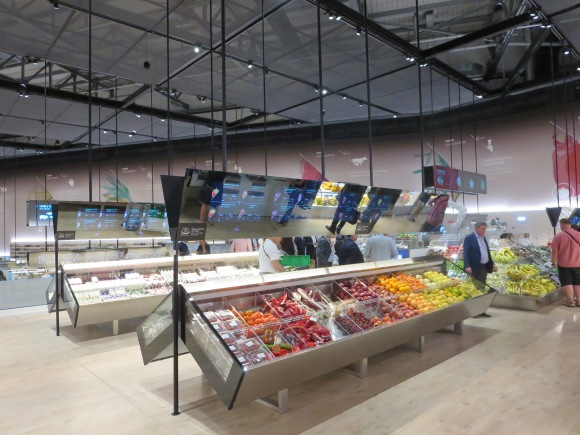 Supermarket of the Future: This was very cool. It's an operational supermarket with a bunch of high-tech stuff. Point at food and the screens above show you the nutritional information, price, etc. Robot arms pick up and package fruit. And after you check out, you get to carry your grocery bags around the Expo all day. Yay!